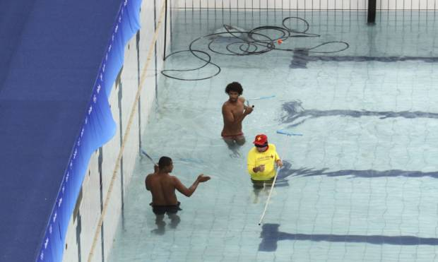 Pictures: Draining Rio's green pool