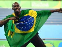 Bolt seals 'triple triple' with relay gold