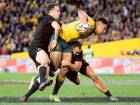 Australia's Israel Folau is tackled by New Zealand's Israel Dagg, right, and Ben Smith during their Bledisloe Cup Rugby test match in Sydney on Saturday.
