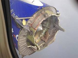 Mid-air horror as plane engine torn apart