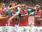 West Ham United's Michail Antonio celebrates scoring their first goal with team mates.