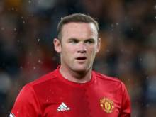 Rooney keeps job as England captain