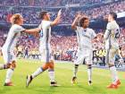 Real Madrid's Alvaro Morata celebrates a goal with teammates Luka Modric, Marco Asensio and Marcelo. Real successfully pitched a Morata buyback to Juventus in a €30-million deal.