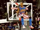 Bull Bullard of the Harlem Globetrotters sits on top of a ring. The Globetrotters will showcase incredible ball-handling wizardry, rim-rattling dunks, trick shots and hilarious comedy.