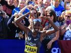 Britain's Mo Farah does his 'mobot' celebration after winning the men's elite race in the Great North Run half-marathon in South Shields, north east England on September 11, 2016.