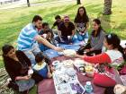 A group of residents enjoy a picnic at Buhairah Corniche in Sharjah.