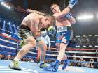 Canelo Alvarez lands a punch on Liam Smith during the eighth round of the WBO Junior Middleweight championship fight at the stadium in Arlington, Texas on Saturday. Alvarez won with a knock out in the ninth round.