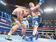 Alvarez knocks out Smith for share of title