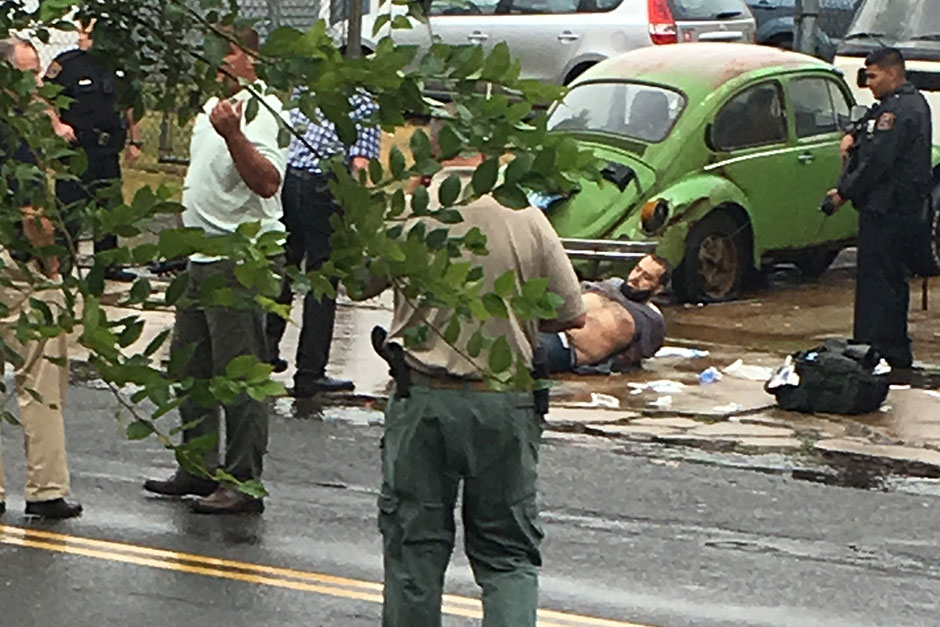 Ahmad Khan Rahami is taken into custody after a shootout with police in Linden