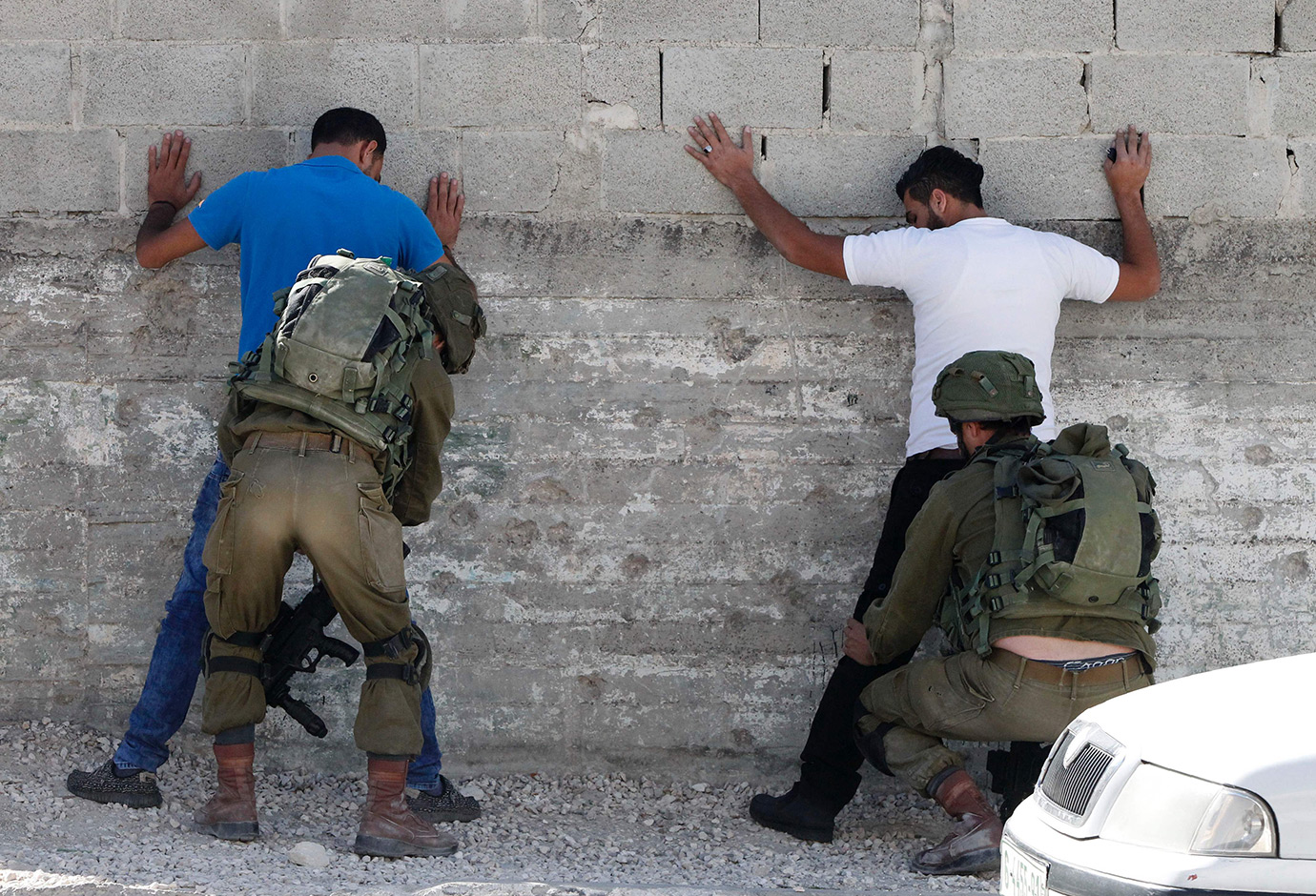 Israeli security forces body search Palestinians