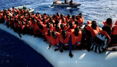 Migrants plucked from overloaded dinghy