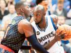 Minnesota Timberwolves' Kevin Garnett (right) drives on Atlanta Hawks' Paul Millsap in the first quarter of an NBA game in Minneapolis. Garnett has informed the Timberwolves that he will retire after 21 seasons.