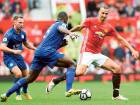 Manchester United's Swedish striker Zlatan Ibrahimovic (right) takes on Leicester City's English midfielder Danny Drinkwater (left) and English-born Jamaican defender Wes Morgan during the English Premier League match at Old Trafford yesterday.