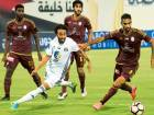 Sultan Al Ghafri of Al Wahda and Mohammad Jamal ofAl Jazira fight for the ball during the Arabian Gulf League match at Al Nahyan Stadium in Abu Dhabi on Friday night.