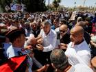 Police try to prevent relatives of Nahed Hatter and activists to block the street during a sit-in in front of the prime minister's building in Amman on Monday.