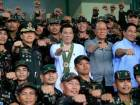 Philippines President Rodrigo Duterte (C) clenches fist with members of the Philippine Army during his visit at the army headquarters in Taguig city, metro Manila, Philippines October 4, 2016.