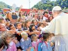 Pope Francis greets pupils outside a school in ArquataDel Tronto, Italy on Tuesday.