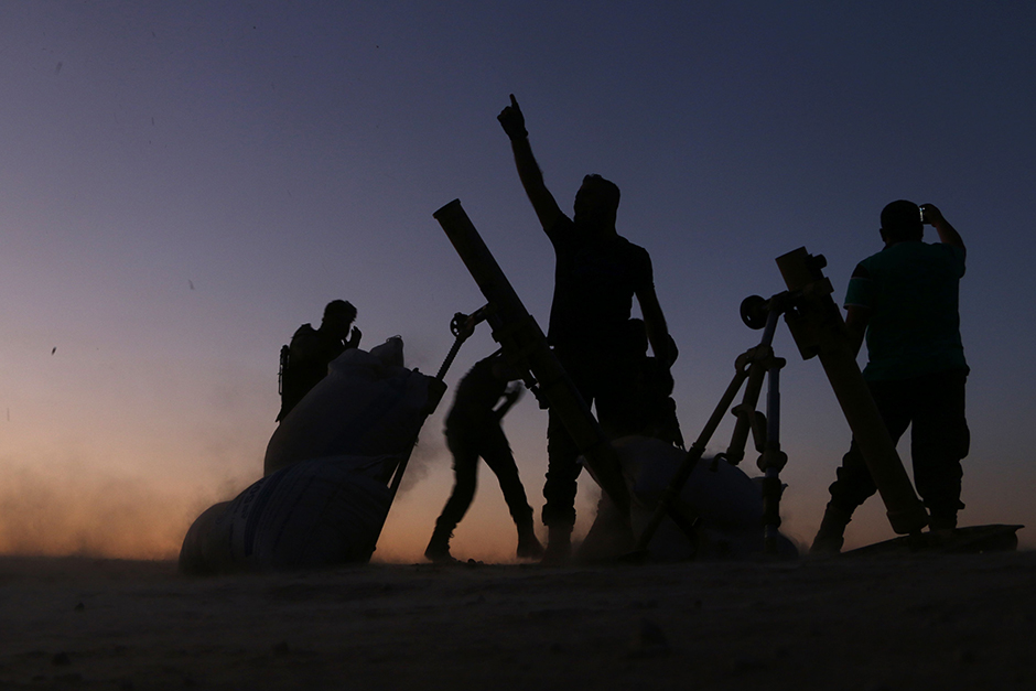 Fighters from the Free Syrian Army cheer