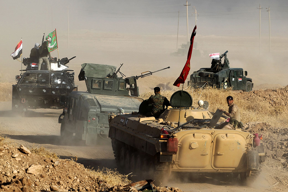 Iraqi forces deploy in the area of Al Shourah, some 45 kms south of Mosul