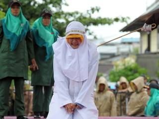 Cheers as woman caned in public