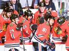 Chicago Blackhawks players mob Marian Hossa (81) after he scored his 500th career goal during the second period against the Philadelphia Flyers on Tuesday.