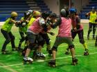 South African women practice Roller Derby during a training session on August 24, 2016 in Johannesburg.  South African women are taking to roller derby - a high-tempo contact sport they say is highly empowering and helps them celebrate their bodies. And it is gaining popularity since it was launched in the country in 2010. / AFP / MUJAHID SAFODIEN