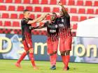 Al Ahli players celebrate a goal against minnows Dibba during a Arabian Gulf League match.