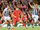 West Bromwich Albion's James Morrison (left) and Nacer Chadli (right) fight for the ball with Liverpool's Adam Lallana.