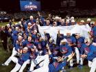 The Chicago Cubs celebrate after a 5-0 series-clinching win against the Los Angeles Dodgers in Game 6 of the National League Championship Series at Wrigley Field on Saturday.