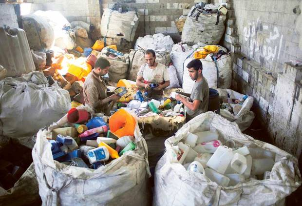 Gaza factory turns to recycling to survive