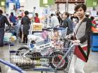 A customer at a Wal-Mart store during its opening day in Tianjin, China, on Wednesday. The world's largest retailer is making an ambitious push into e-commerce in China.