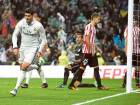 Real Madrid's forward Alvaro Morata (left) celebrates after scoring the late winner against Athletic Bilbao during the Spanish league match at the Santiago Bernabeu stadium in Madrid on Sunday.