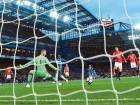 Chelsea's French midfielder N'Golo Kante (centre) scores their fourth goal during the match against Manchester United at Stamford Bridge in London on Sunday. Chelsea breezed past Man United 4-0.