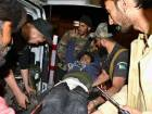 Volunteers and police officers rush an injured cadet of Balochistan Police College to a hospital in Quetta on Monday after the terrorist attack.