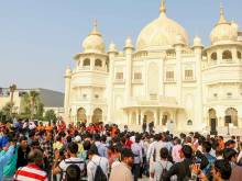 Workers attend preview of Bollywood parks