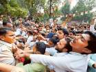 Police trying to control the supporters of UP Chief Minister Akhilesh Yadav who were shouting slogans outside the samajwadi Party office in Lucknow.