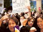 Supporters shout Philippine President Rodrigo Duterte's name as they wait for his arrivalat a hotel in Tokyo, Japan, yesterday.