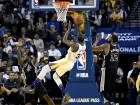 Kevin Durant #35 of the Golden State Warriors shoots and gets fouled by Jonathon Simmons #17 of the San Antonio Spurs during the third quarter in an NBA basketball game at ORACLE Arena on October 25, 2016 Oakland, California.