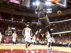 Cleveland Cavaliers forward LeBron James (23) dunks in the first half against the New York Knicks at Quicken Loans Arena.  Cleveland trounced the new-look Knicks 117-88.