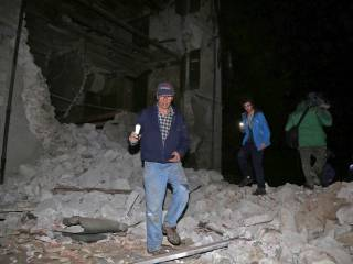 Buildings collapse as 2 quakes hit Italy