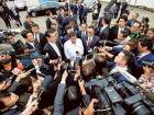 Philippine President Rodrigo Duterte (centre) speaks to journalists after his inspection at the Japan Coast Guard base in Yokohama, south of Tokyo, on Thursday.
