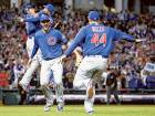 Kris Bryant (centre) and Anthony Rizzo (number 44) of the Chicago Cubs celebrate after defeating the Cleveland Indians to win their first World Series in 108 years.