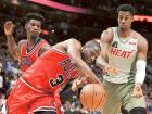 Delighted Wade beats Heat in Miami return