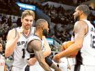 Leonard pushes Spurs to tame the Heat