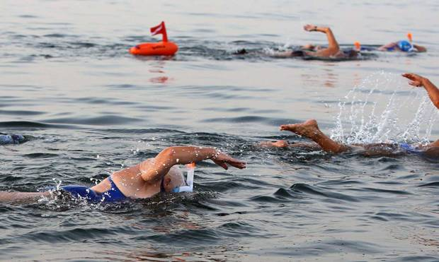 Swimmers complete 7-hour crawl across Dead Sea
