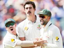 Aussies seize control in day-night contest