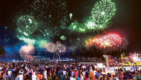 Festive scenes amid waves of  colour, music