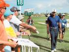 Tiger Woods walks off the 18th green following the round two of the Hero World Challenge at Albany, The Bahamas on Friday.