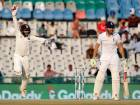 India's wicketkeeper Parthiv Patel celebrates after taking catch of England's Jonny Bairstow on the third day of their third cricket test match in Mohali, India.