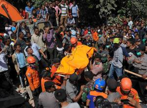 54 dead, dozens trapped in Indonesia quake